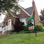 house with a sign saying sold