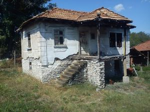 Rural property consisting of two houses,barn and big plot of land located near the center of a big village 10 km away from the town of Vratza,Bulgaria