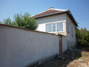 Solid country house with garage and plot of land