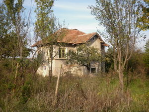 Old rural house with plot of land situated in small village