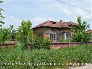 Large plot of land with old rural brick house