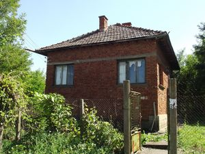 Old house with land located in a village near river & fields