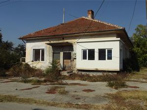 Old bakery with storage, shop & land in big village for sale