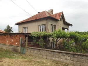 Rural house with barn and plot of land in village near lake