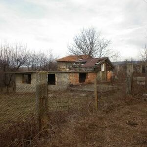 Rural property consisting of an uncompleted house,garage and a plot of land